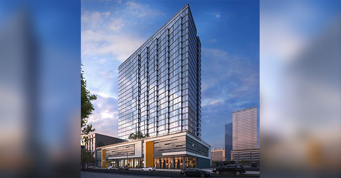 Draper and Kramer tops off and reveals name of 275-unit apartment tower in Chicago's South Loop